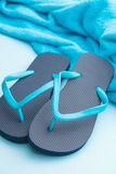 Blue flip flops. Blue flip flops with towel royalty free stock photography