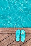 Blue flip flops on a wooden deck stock images