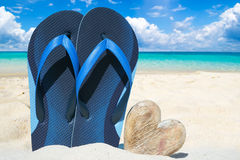 Blue flip flops and wooden heart Royalty Free Stock Photos