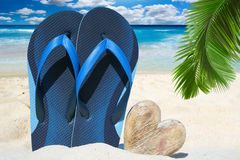 Blue flip flops and wooden heart Royalty Free Stock Image