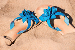Blue flipflops on sand. Sunny day stock photography