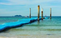 Blue floating walk way pontoon and blue sky. In koh lan thailand Stock Photo