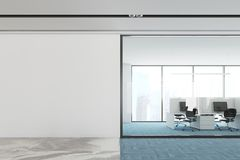 Blue floor open space office interior mock up wall. Modern open space office interior with a blue carpet floor, white and glass walls, and computer tables. A Stock Photo