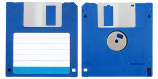Blue floppy disk. Front and back of a blue floppy disk over a white background Royalty Free Stock Images