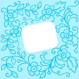 Blue floral background. White frame on a blue floral background Stock Photos