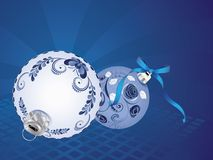 Blue Floral Christmas Ball. Festive christmas ball decorated with blue floral ornaments Royalty Free Stock Images