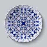 Blue floral circular pattern. Decorative ceramic plate. Royalty Free Stock Images
