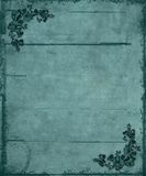 Blue Floral Corners Grunge Background. A textured grunge background in blue with floral corners Stock Photography