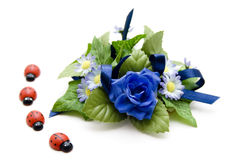 Blue floral decoration with ladybug Stock Photos