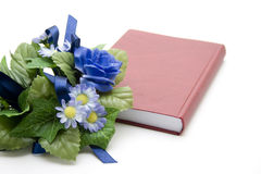 Blue floral decoration with red book Stock Image