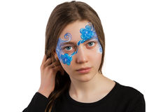 Blue floral ornament face painting. Teenage girl with blue floral ornament face painting in the studio isolated on white background royalty free stock photos