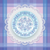 Blue floral ornament on a plate. Stock Images