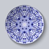 Blue floral pattern on a dish. Pastiche of Chinese porcelain painting. Royalty Free Stock Images
