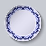 Blue floral pattern on the rim of the plate. Imitation of Chinese porcelain painting. Royalty Free Stock Photography