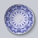 Blue floral pattern on a round plate. Stylization of Chinese porcelain painting. Royalty Free Stock Photo