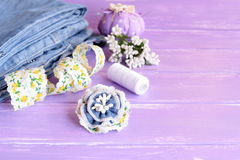 Blue flower brooch made of old jeans, lace and artificial stamens Royalty Free Stock Photo