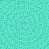 Blue Flower Pattern background. The blue flowers in a circular pattern on a light green background Royalty Free Stock Photo