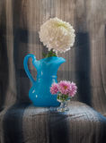 Blue flower vase white and purple chrysanthemum Royalty Free Stock Photos