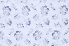 Blue flowers. White textile with pattern of blue flowers Royalty Free Stock Images