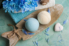 Blue flowers and bath bombs Royalty Free Stock Photos