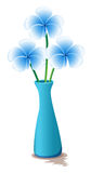 Blue flowers in a blue vase Stock Photos