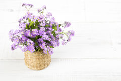 Blue flowers bouquet on white wooden background Stock Image