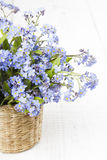 Blue flowers bouquet on white wooden background Stock Images
