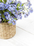 Blue flowers bouquet on white wooden background Royalty Free Stock Images