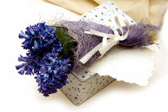 Blue flowers, box and greeting card. Bouquet of blue hyacinth and on the box stock image