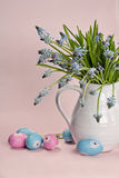 Blue flowers with colored eggs Stock Images