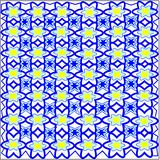 Blue flowers and leaves and yellow flowers woven into a pattern on a white background. Abstract blue flowers and leaves and yellow flowers are laid out in rows Royalty Free Stock Image