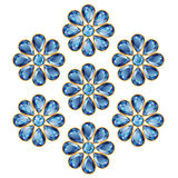 Blue Flowers of Sapphires Isolated Objects. Pattern of seven blue flowers composed of sapphire gemstones. Mid flower - round stone, petals in the form of drops Stock Photography