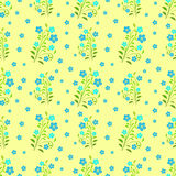 Blue flowers seamless pattern on yellow background Stock Photos