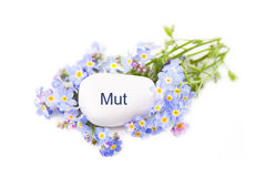 Blue flowers with stone - Mut - in german words Royalty Free Stock Photos