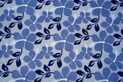 Blue flowers on textil background Royalty Free Stock Photography