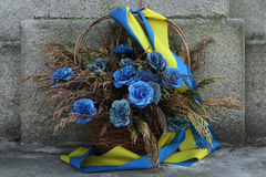Blue flowers with Ukrainian national flags. Stock Images