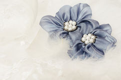 Blue flowers on white lace Royalty Free Stock Photo