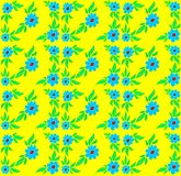Blue flowers on a yellow background. Seamless texture - blue flowers on a yellow background Stock Photos