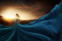 Blue flowing dress. A woman wearing a large and flowing blue dress Stock Photo
