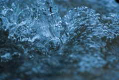 Blue Flowing Water 2247. Blue flowing water in a fountain generating life and energy stock photo