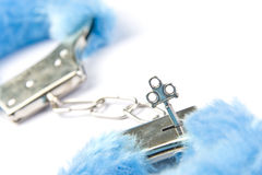 Blue fluffy handcuffs Royalty Free Stock Photos