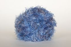 Blue fluffy yarn. On white fone stock photo