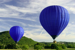 Blue flying hot air balloon stock photo