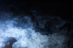 Blue Fog texture on Black Background. Detailed texture of fog and smoke photographed in a studio on a black background Stock Images