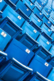 Blue folded seats in a stadium Royalty Free Stock Images