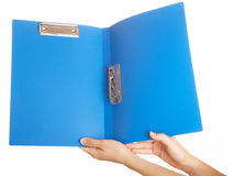 Blue folder. For papers in a hand on a white background royalty free stock images