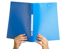 Blue folder. For papers in a hand on a white background stock images