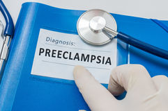 Blue folder with patient files with Preeclampsia diagnosis.  stock images