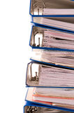 Blue folder stack. A stack of filled ring binders isolated on white Stock Image