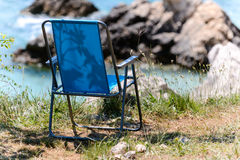 Blue folding chair Stock Image